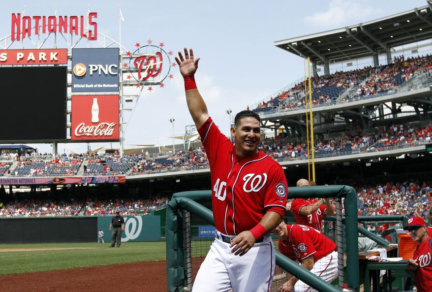 Washington Nationals' Wilson Ramos (40) acknowledges the crowd after his grand slam during the third inning of a baseball game against the New York Mets at Nationals Park, Sunday, July 28, 2013, in Washington. (AP Photo/Alex Brandon)