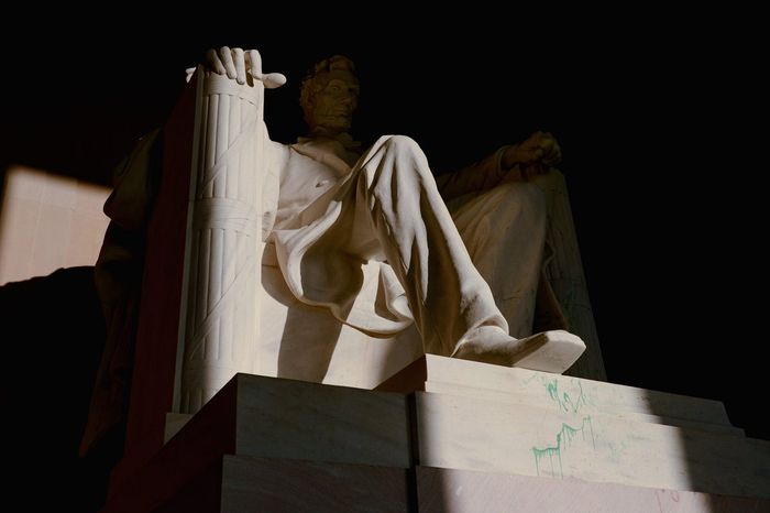 With splotches of green paint still visible Monday on the Lincoln Memorial, D.C. Metropolitan Police announced the arrest of a woman at the Washington National Cathedral after similar vandalism was found there.