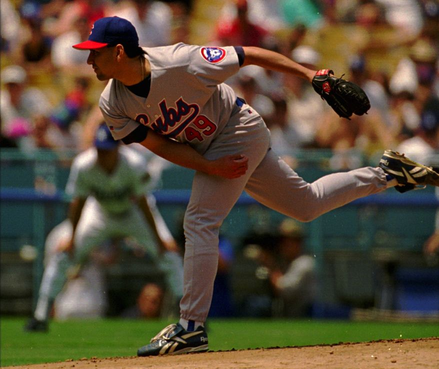 **FILE** Chicago Cubs pitcher Frank Castillo sends a pitch to the plate in the late innings of their game against the Los Angeles Dodgers Sunday, April 28, 1996, at Dodger Stadium. Castillo scattered six Dodger hits without allowing a run in his complete-game, 3-0 shutout of the Dodgers. (AP Photo/Reed Saxon)