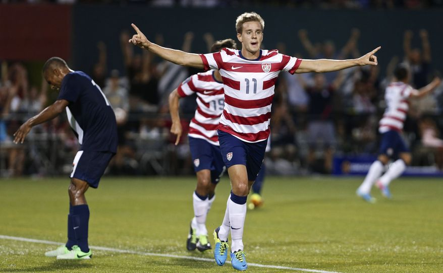 **FILE** In this July 9, 2013, file photo, the United States' Stuart Holden celebrates his second half goal against Belize during a CONCACAF Gold Cup soccer match at Jeld-Wen Field in Portland, Ore. The U.S. midfielder, who has fought a severe knee injury for two and a half years, finally got in a full 90 minutes for the first time since September 2011 when the United States beat Costa Rica 1-0 in a Gold Cup match on July 16. (AP Photo/The Oregonian, Thomas Boyd, File)