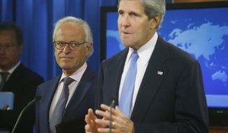 Secretary of State John Kerry stands with former U.S. Ambassador to Israel Martin Indyk at the State Department as he announces that Indyk will shepherd the Israeli Palestinian peace talks beginning in Washington on July 29, 2013. (Associated Press)