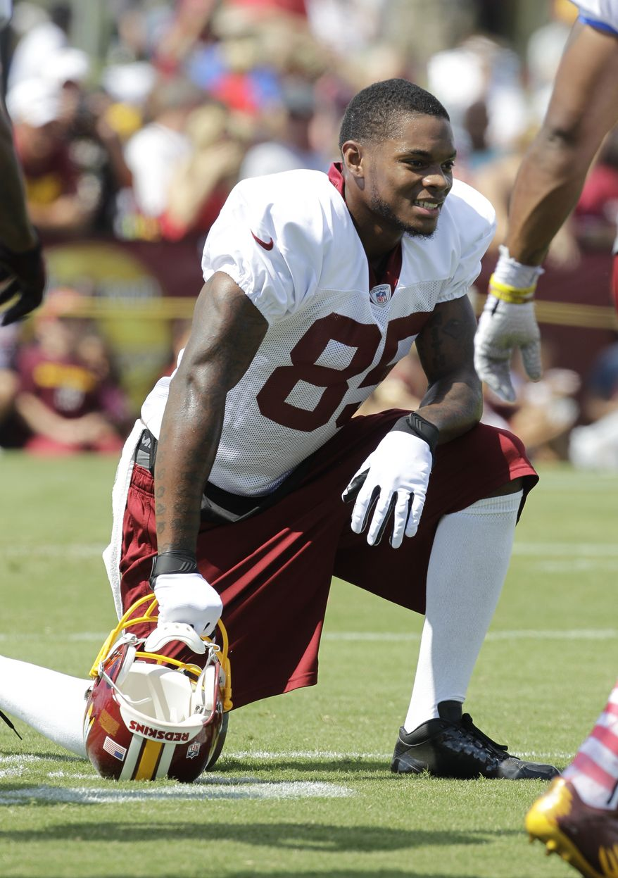 Washington Redskins wide receiver Leonard Hankerson (85) takes a break during the second day of the NFL football teams training camp in Richmond, Va. Friday, July 26, 2013. (AP Photo/Steve Helber)