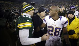 Minnesota Vikings running back Adrian Peterson (28) is the top-rated fantasy player heading into 2013, but Green Bay Packers quarterback Aaron Rodgers (12) is worth a high pick. (AP Photo/Jeffrey Phelps)