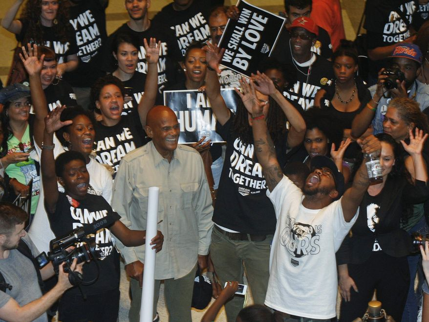 American singer, songwriter, actor and social activist Harry Belafonte, Jr., center, reacts as Dream Defenders Executive Director Phillip Agnew, bottom left, leads a chant Friday, July 26, 2013, in the Capitol rotunda in Tallahassee, Fla. (AP Photo/Phil Sears)