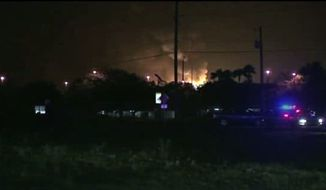 This frame grab from an Associated Press video shows flames from a gas plant explosion in Tavares City, Fla., Monday, July 29, 2013. A series of major explosions at has injured several workers and left others missing. (AP Photo)