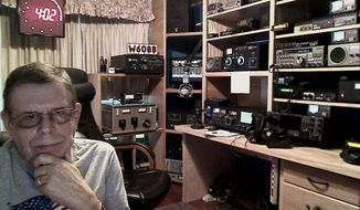 Radio's master of the paranormal and outward edges of science, Art Bell (shown here at his home studio in Pahrump, Nev.), will return to the microphone on September 15 with a new nighttime show on Sirius XM radio. (AP Photo/SiriusXM)