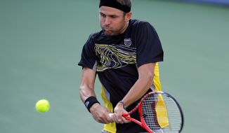 Mardy Fish hits the ball during his match against Matthew Ebden, from Australia, at the Citi Open tennis tournament, Monday, July 29, 2013 in Washington. Fish won 2-6, 6-1, 6-3. (AP Photo/Alex Brandon)