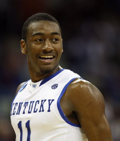 **FILE** Kentucky guard John Wall smiles during the second half of an NCAA second-round college basketball game against Wake Forest in New Orleans, Saturday, March 20, 2010. (AP Photo/John Bazemore)