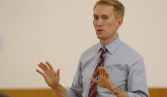 **FILE** Rep. James Lankford, Oklahoma Republican, speaks during a town hall meeting in Del City, Okla., on July 2, 2013. (Associated Press)