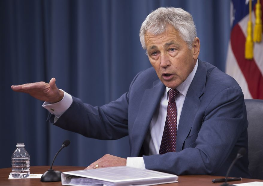 ** FILE ** Defense Secretary Chuck Hagel speaks during a news conference at the Pentagon on July 31, 2013. (Associated Press)