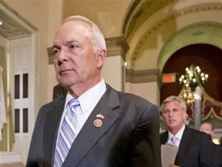 ** FILE ** House Education Committee Chairman Rep. John Kline, R-Minn., left, followed by House Majority Whip Kevin McCarthy of Calif., walks to the House chamber on Capitol Hill in Washington, July 17, 2013. (AP Photo/J. Scott Applewhite)