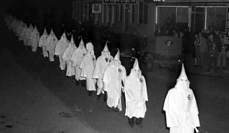 Ku Klux Klansmen march through Swainsboro, Georgia, on Feb. 4th, 1948. (Associated Press) ** FILE **