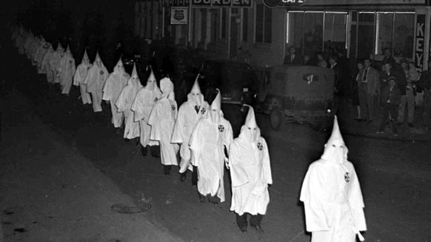Ku Klux Klansmen march through Swainsboro, Georgia, on Feb. 4th, 1948. (Associated Press) ** FILE **