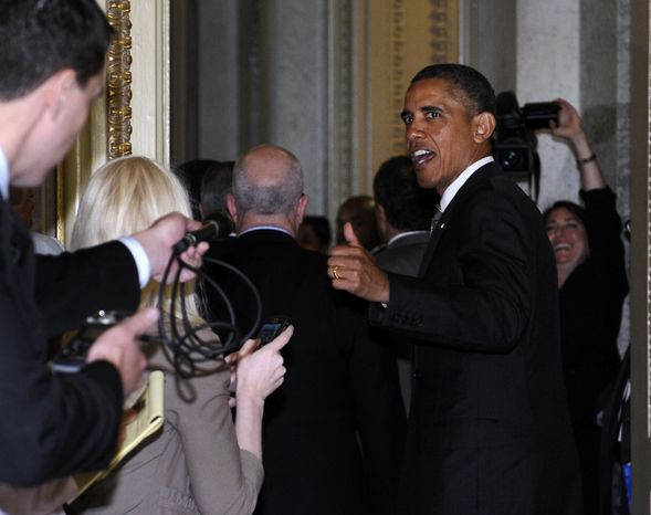 President Obama responds to a reporter's question as he leaves a meeting with Senate Democrats on Capitol Hill in Washington on July 31, 2013. (Associated Press)