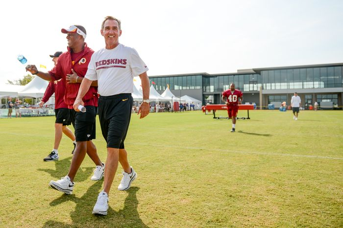 Washington Redskins defensive backs coach Raheem Morris, left, and Washington Redskins head coach Mike Shanahan arrive for morning walkthroughs at the Bon Secours Washington Redskins Training Center, Richmond, Va., Tuesday, July 30, 2013. (Andrew Harnik/The Washington Times)