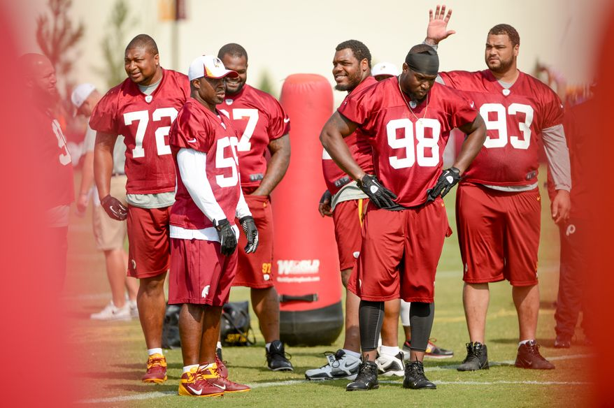 Washington Redskins inside linebacker London Fletcher (59), left, and Washington Redskins outside linebacker Brian Orakpo (98), second from right, and others during team walkthroughs at the Bon Secours Washington Redskins Training Center, Richmond, Va., Tuesday, July 30, 2013. (Andrew Harnik/The Washington Times)