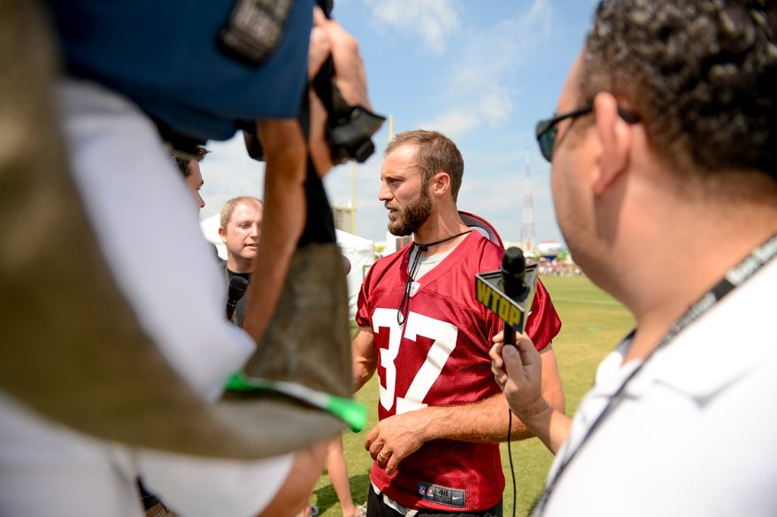 Washington Redskins strong safety Reed Doughty (37) speaks to reporters after morning walkthroughs at the Bon Secours Washington Redskins Training Center, Richmond, Va., Tuesday, July 30, 2013. (Andrew Harnik/The Washington Times)