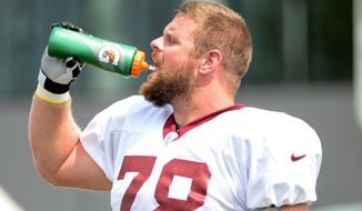 Washington Redskins guard Kory Lichtensteiger (78) takes a water break during warmups before afternoon practice at the Bon Secours Washington Redskins Training Center, Richmond, Va., Tuesday, July 30, 2013. (Andrew Harnik/The Washington Times)
