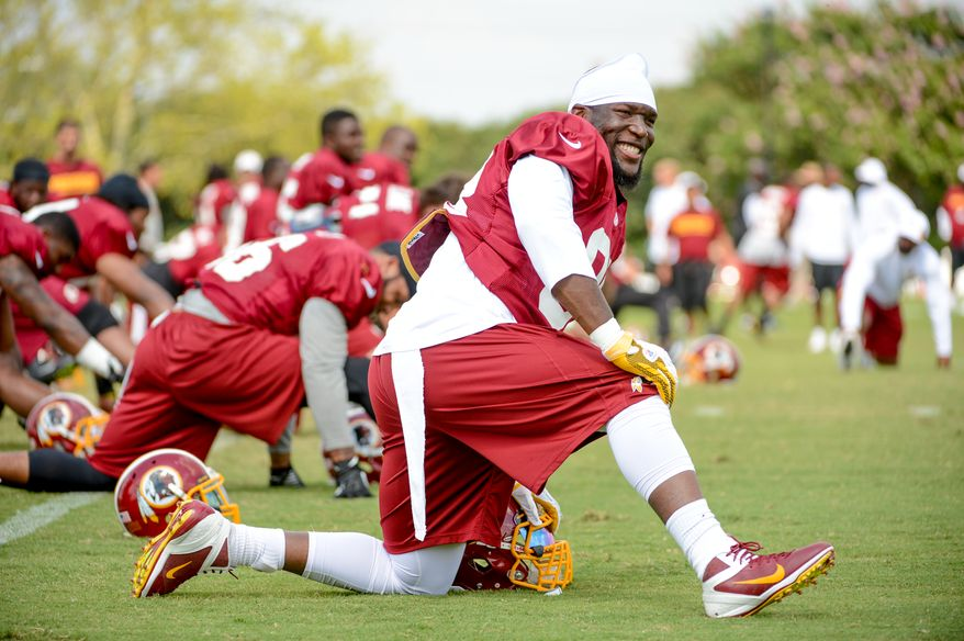 Washington Redskins outside linebacker Brian Orakpo (98) stretches before afternoon practice at the Bon Secours Washington Redskins Training Center, Richmond, Va., Tuesday, July 30, 2013. (Andrew Harnik/The Washington Times)