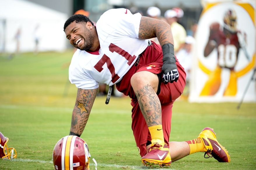 Washington Redskins tackle Trent Williams (71) laughs during afternoon practice at the Bon Secours Washington Redskins Training Center, Richmond, Va., Tuesday, July 30, 2013. (Andrew Harnik/The Washington Times)