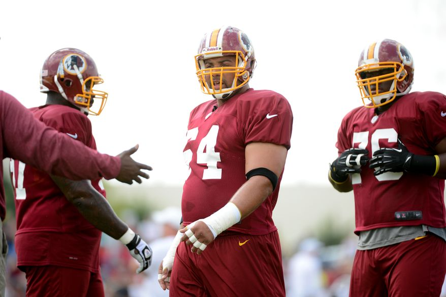 Washington Redskins defensive tackle Kedric Golston (64), center, during afternoon practice at the Bon Secours Washington Redskins Training Center, Richmond, Va., Tuesday, July 30, 2013. (Andrew Harnik/The Washington Times)