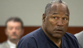 ** FILE ** O.J. Simpson listens during an evidentiary hearing in Clark County District Court, Thursday, May 16, 2013, in Las Vegas. (AP Photo/Julie Jacobson, Pool, File)