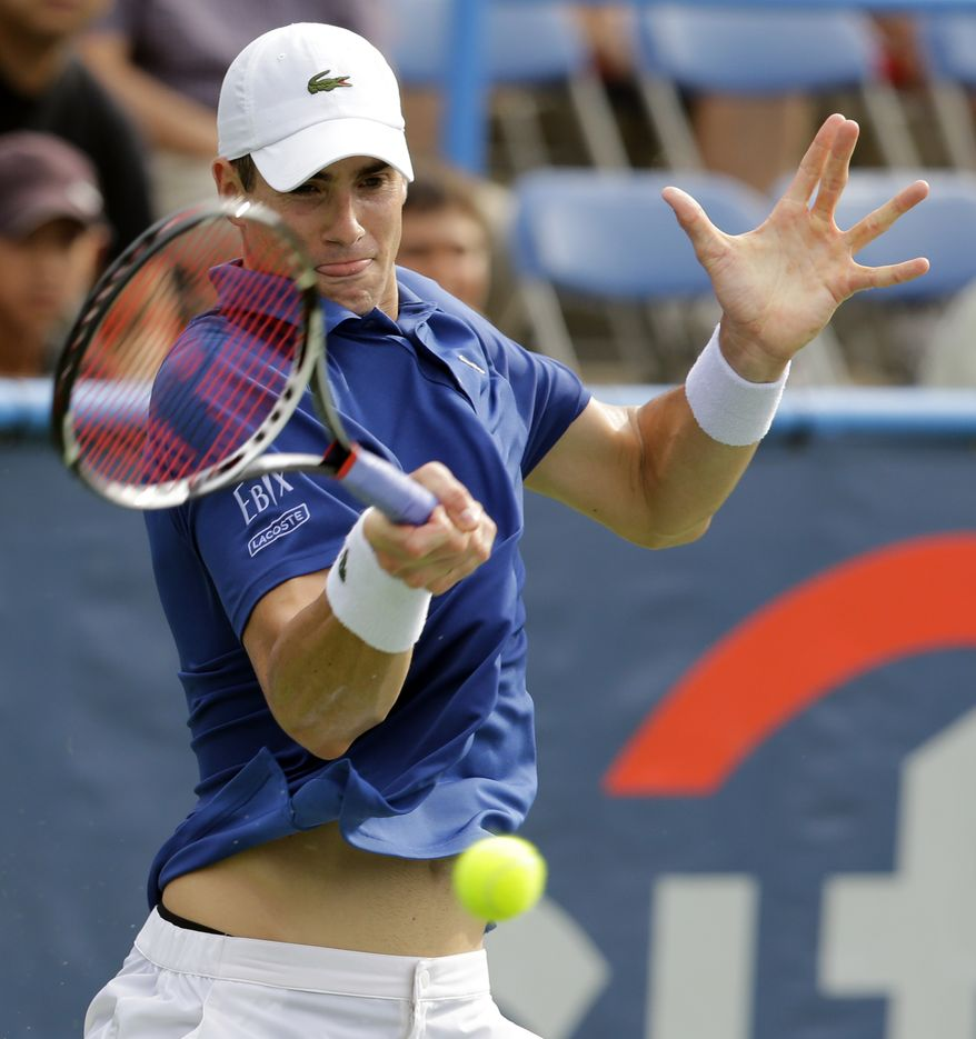 John Isner hits the ball during his match against Alex Kuznetsov at the Citi Open tennis tournament, Wednesday, July 31, 2013, in Washington. Isner won 7-6 (2), 7-6 (4). (AP Photo/Alex Brandon)