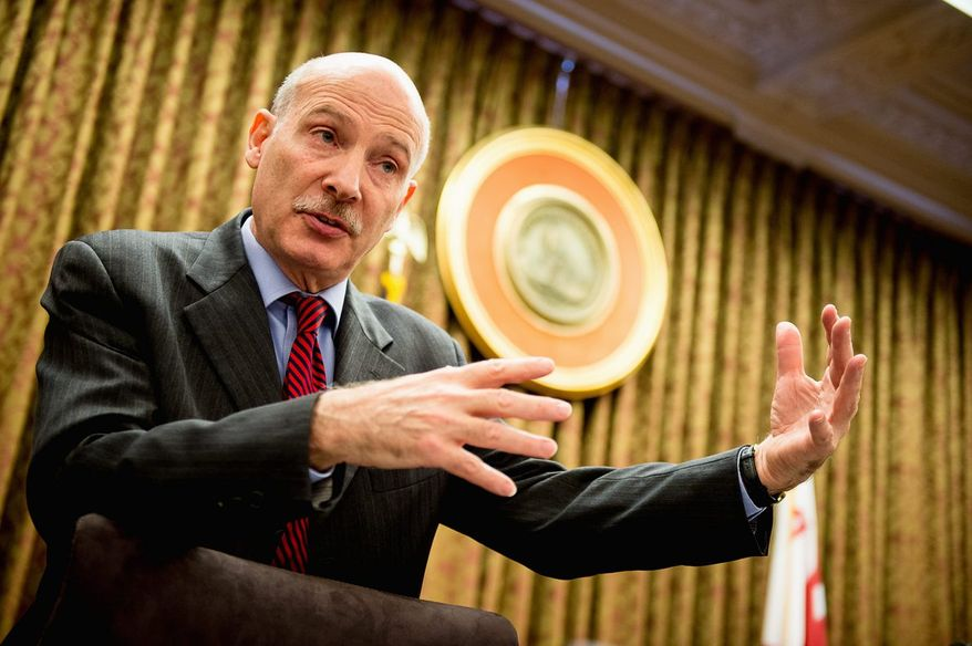 D.C. Council Chairman Phil Mendelson said the bill requiring certain larger retailers to pay a higher minimum wage still has not yet reached his desk. It will then go to Mayor Vincent C. Gray to sign off on it or veto it. (Andrew Harnik/The Washington Times)