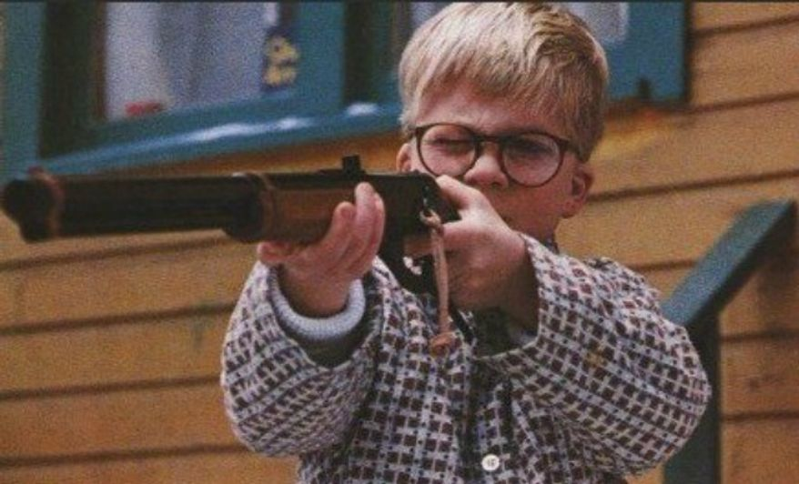 "Actor Scott Schwartz fires his ""Red Rider BB gun"" in 1983's ""A Christmas Story."" (Image: Metro-Goldwyn-Mayer)"