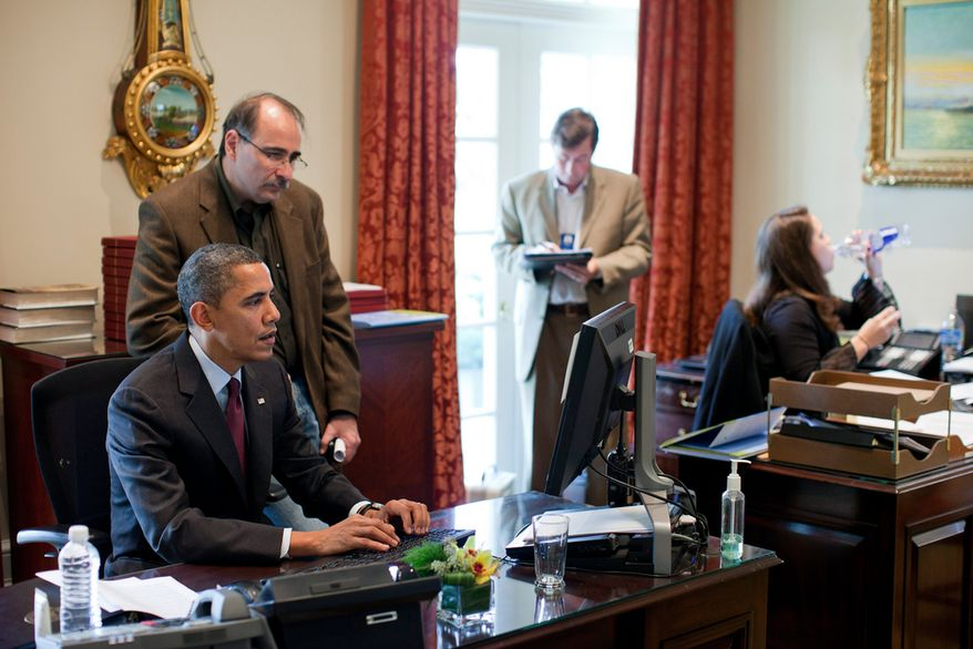 President Barack Obama and Senior Advisor David Axelrod work on a computer in the Outer Oval Office, Dec. 4, 2010. (White House photo by Pete Souza)