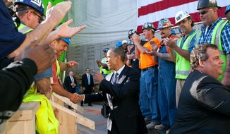 President Barack Obama and New Jersey Governor Chris Christie, right, greet workers during a tour of the One World Trade Center site in New York, N.Y., June 14, 2012. (Official White House Photo by Pete Souza)