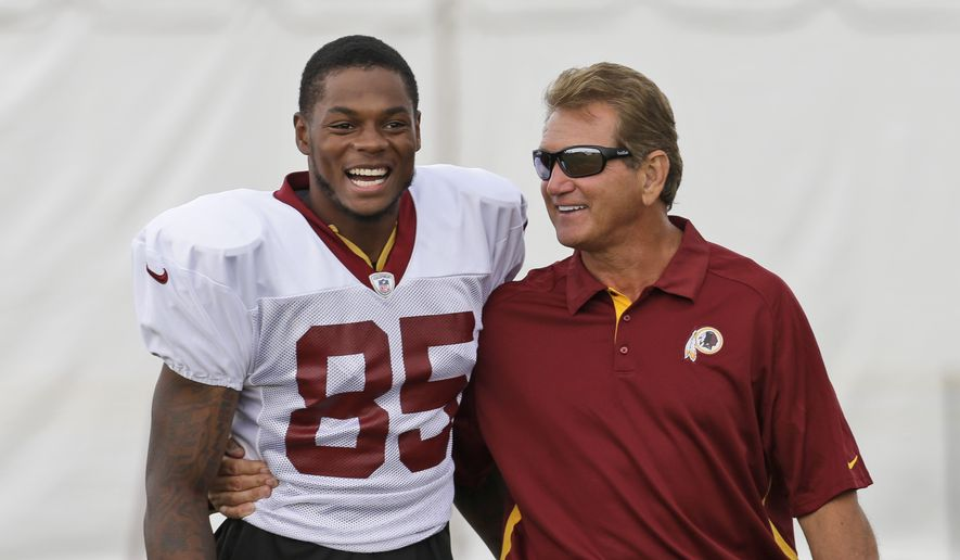 Washington Redskins wide receiver Leonard Hankerson (85) laughs as he walks with former Redskins quarterback Joe Theismann during the afternoon practice at the NFL football teams training camp in Richmond, Va. Wednesday, July 31, 2013. (AP Photo/Steve Helber) ** FILE **