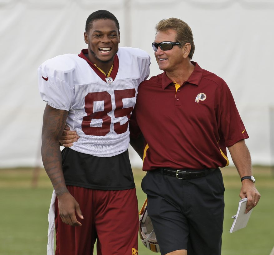 Washington Redskins wide receiver Leonard Hankerson (85) laughs as he walks with former Redskins quarterback Joe Theismann during the afternoon practice at the NFL football teams training camp in Richmond, Va. Wednesday, July 31, 2013. (AP Photo/Steve Helber)