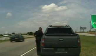 A Texas cop is in trouble after taking a cell phone picture of his traffic stop with George Zimmerman. Mr. Zimmerman is the Fla. neighborhood watchman who was found innocent of second-degree murder in the shooting death of teenager Trayvon Martin. (Associated Press video screenshot)