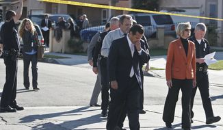**FILE** Los Angeles Mayor Antonio Villaraigosa (third from right) and Janice Hahn Councilperson with the District 15 (second from right) walk past a police line as they arrive to address the community and expresses their condolences over the death of a medical technician, who apparently distraught over losing his job at a hospital, fatally shot his wife, five young children and himself at their harbor-area home in the Wilmington area of Los Angeles on Jan. 27, 2009. (Associated Press)
