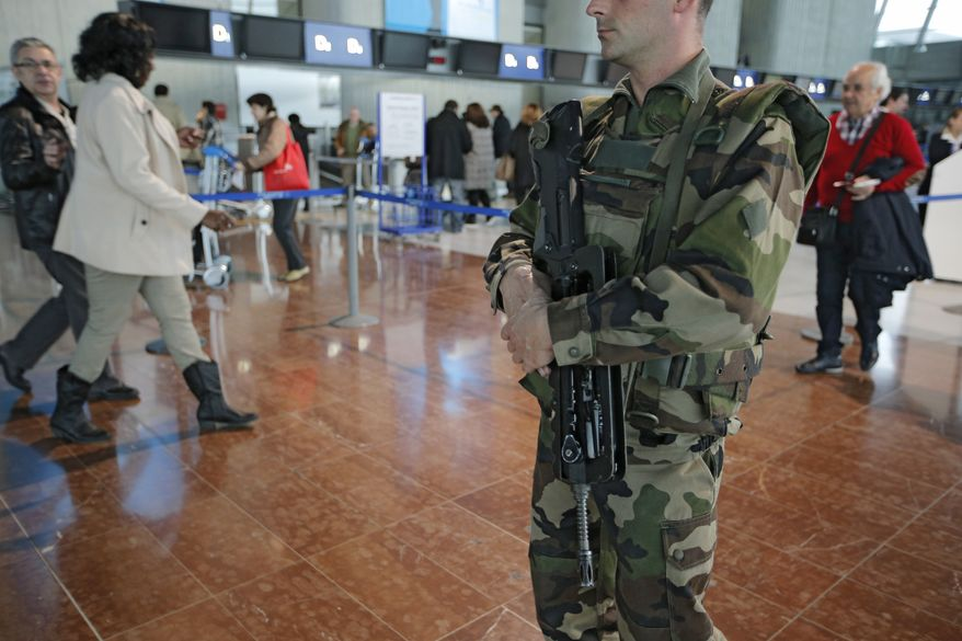 **FILE** A French soldier patrols Nice airport in southern France on Jan. 13, 2013. (Associated Press)
