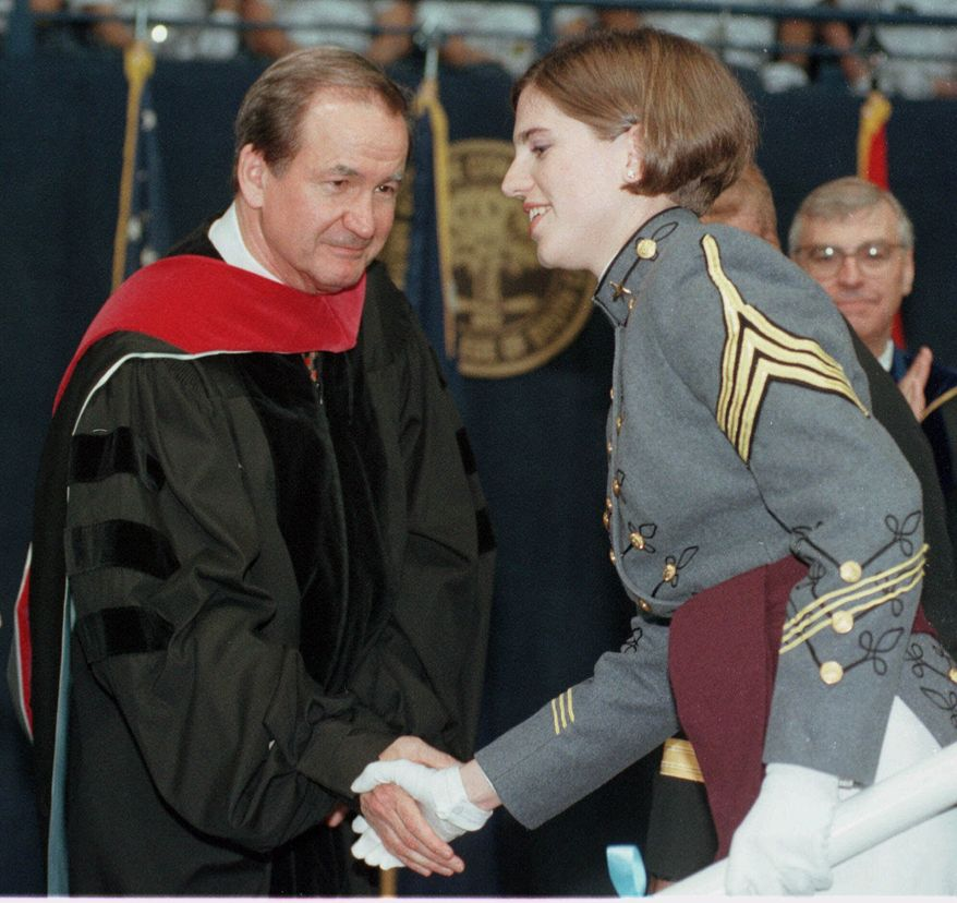 **FILE** Republican presidential hopeful Pat Buchanan shakes hands on May 8, 1999, with Nancy Ruth Mace as she became the first female graduate of The Citadel in Charleston, S.C. Neither Citadel officials nor Buchanan mentioned Mace or the school's controversial all-male admission's policy during the ceremony. Mace entered The Citadel in 1996 after the school dropped that policy. (Associated Press)