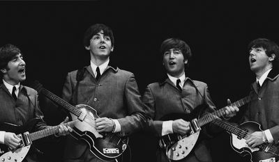 This Feb. 11, 1964 image shows a photograph of John Lennon and Paul McCartney taken by photographer Mike Mitchell during the Beatles' first live U.S. concert at the Washington Coliseum. (AP Photo/David Anthony Fine Art, Mike Mitchell)