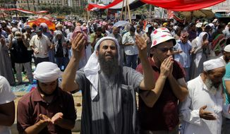 "Supporters of Egypt's ousted President Mohammed Morsi attend Friday prayers at a camp near Cairo University in Giza, southwest of Cairo, Egypt, Friday, Aug. 2, 2013. An international human rights group has warned of a ""bloodbath"" if Egypt's new leadership uses force to end sit-ins by loyalists of the country's ousted president. (AP Photo/Amr Nabil)"