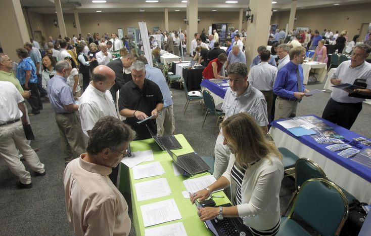 **FILE** People fill up the room at the job fair on July 15, 2013, in South Burlington, Vt. (Associated Press)
