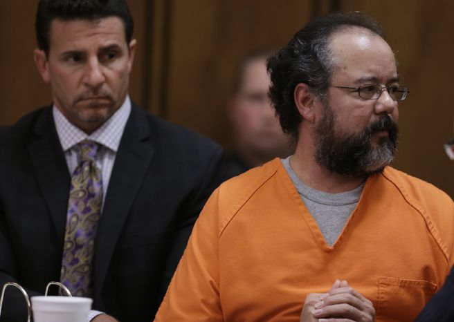 ** FILE ** Ariel Castro looks at Michelle Knight, one of three women whom he was convicted of holding captive, as he speaks during the sentencing phase of his trial on Thursday, Aug. 1, 2013, in Cleveland. (AP Photo/Tony Dejak)