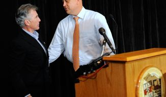 "Hall of Fame baseball player Cal Ripken Jr., right, speaks to John Walsh, former host of ""America's Most Wanted"" during a news conference to announce a $100,000 reward for information in connection to the unsolved abduction of Ripken's mother, which happened more than a year ago, Thursday, Aug. 1, 2013 at Sports Legends Museum in Baltimore. Vi Ripken was abducted at gunpoint from her Aberdeen, Md., home and held captive for more than 24 hours. (AP Photo/Steve Ruark)"