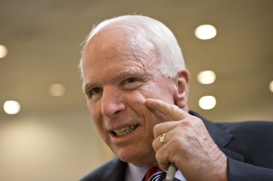 **FILE** Sen. John McCain, Arizona Republican, goes to the floor for a vote on Capitol Hill in Washington on July 31, 2013. (Associated Press)