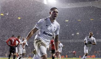 FILE - In this Jan 20, 2013, file photo, Tottenham Hotspur's Clint Dempsey celebrates after scoring a goal against Manchester United during an English Premier League soccer match at White Hart Lane stadium in London. Dempsey is returning to Major League Soccer, ending his six-year spell in English soccer.The 30-year-old Dempsey played for the New England Revolution from 2004-06 before joining Fulham in 2007. He moved to Tottenham last summer and scored 12 goals in 43 games, but wasn't a regular. (AP Photo/Matt Dunham, File)
