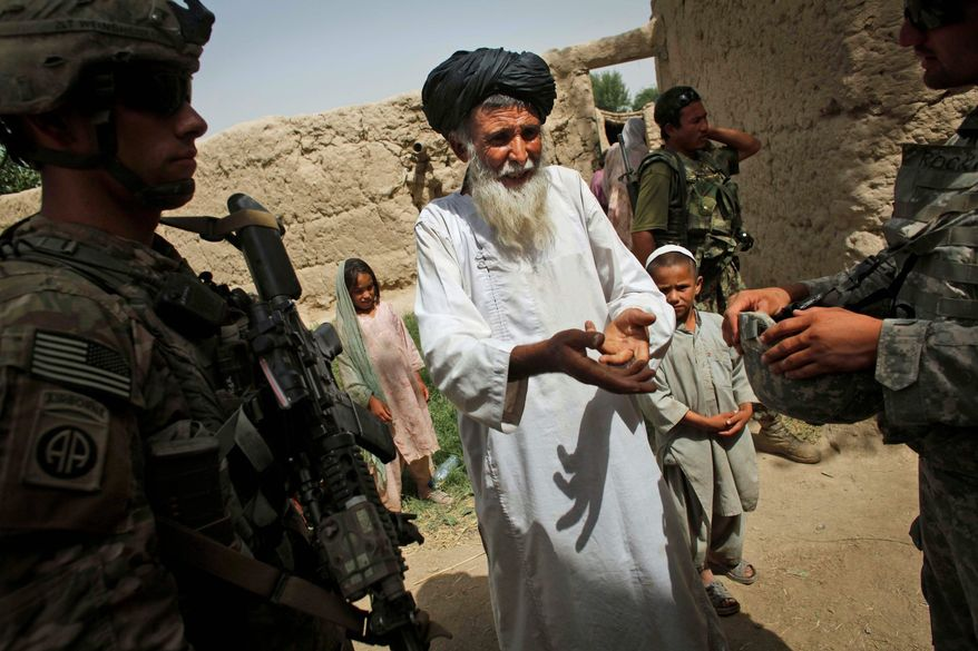 Losing an ally: Mullah Bas Mohammad tells Army Lt. Ross Weinshanker that government authorities rarely visit his village of Charbagh, which relies on NATO troops for security and diplomacy. (Associated Press)