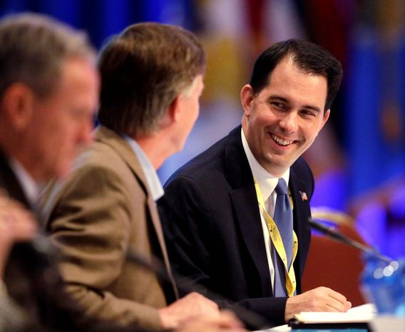 Gov. Scott Walker, Wisconsin Republican, (right) played the role of host,  welcoming his counterparts from across the country. Some of the governors thought to have potential presidential ambitions were a study in contrasts at the Milwaukee meeting. (Associated Press)