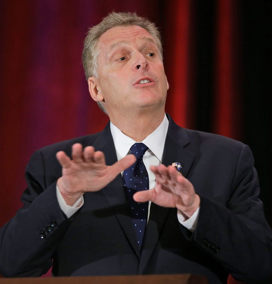 ** FILE ** Democratic gubernatorial candidate, Terry McAuliffe, gestures during the Virginia Bar Association convention debate with Republican challenger, Ken Cuccinelli, at the Homestead in Hot Springs, Va., Saturday, July 20, 2013. (AP Photo/Steve Helber)