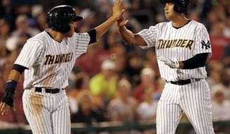 New York Yankees' Alex Rodriguez , right, high-fives Ramon Flores, left, after scoring in the fifth inning of a Class AA baseball game with the Trenton Thunder against the Reading Phillies Saturday, Aug. 3, 2013, in Trenton, N.J. (AP Photo/Rich Schultz)