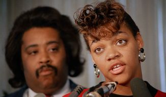 ** FILE ** In this Oct. 8, 1988, file photo, Tawana Brawley speaks to reporters with her adviser, the Rev. Al Sharpton in Chicago. A grand jury concluded Brawley's story of being raped in New York in 1987 was a hoax. The New York Post reports Brawley has begun making defamation payments to the ex-county prosecutor she accused of rape after he won a claim against her and her advisers. (AP Photo/Mark Elias, File)