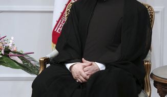 Iranian President Hasan Rouhani, sits in a meeting at the presidency office, in Tehran, Iran, Saturday, Aug. 3, 2013. Iran's supreme leader formally endorsed Hasan Rouhani as president Saturday, allowing the moderate cleric to take charge of a country weakened by economic sanctions over its nuclear program. (AP Photo/Ebrahim Noroozi)